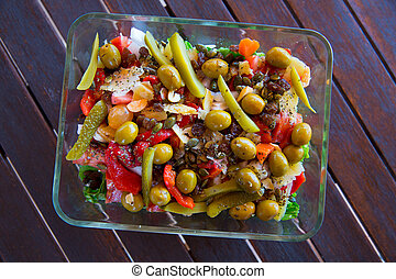 Mediterranean salad with tomato olives cucumber lettuce and...