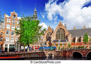 Amsterdam and typical houses with clear summer...
