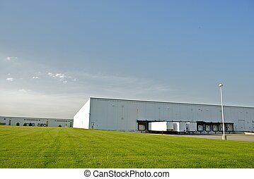 Industrial Zone - Warehouses with Truck Gates and Green...