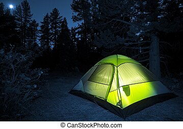 Small Camping Tent Illuminated Inside. Night Hours Campsite....