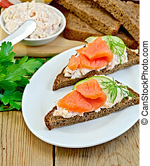 Sandwich with cream and salmon in the dish with dill -...