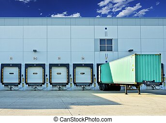 Trailer in a Dock. Warehouse Building with Gates. Business...