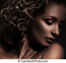 Portrait of young beautiful woman with a huge diamond