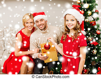 smiling family decorating christmas tree - family,...