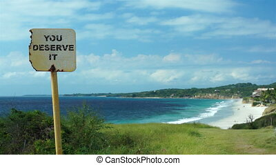 You Deserve It Beach Sign Dolly - Dolly shot of a...