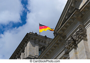 bundestag - Detail of the bundestag and flag of germany.