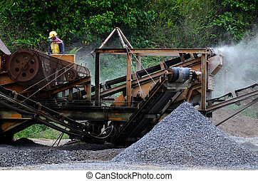 Gravel machine - AITUTAKI - SEP 20:Road worker operates a...
