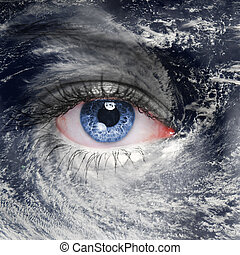 A green eye in the middle of a hurricane - A blue eye in the...
