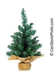 Pine on burlap stand - Small undecorated Christmas tree in...
