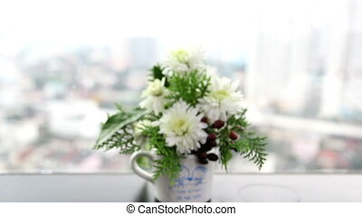 flowers beside the windows