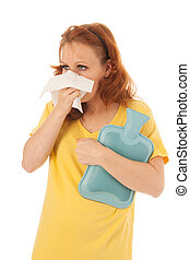 Red haired woman blowing nose with hot water-bottle - Red...