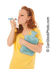 Red haired woman with thermometer
