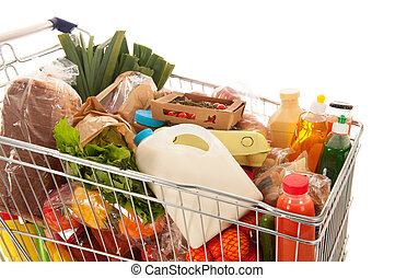 Shopping cart full dairy grocery - Shopping cart full with...