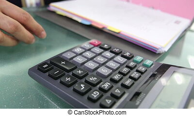 Businessman using a calculator
