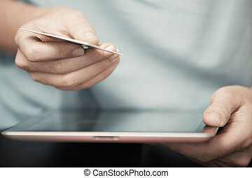 Online banking - Human hands with digital tablet and credit...