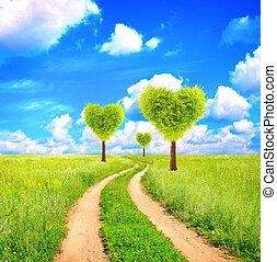 Heart shape trees on green field