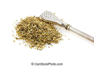 Green mate - Bombilla and mate tea leaves on a white...