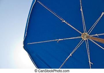 Sun umbrella on a bright, sunny day - A sun umbrella...