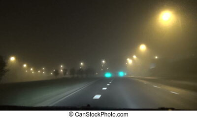 car dense fog light - the car moving toward the dense early...