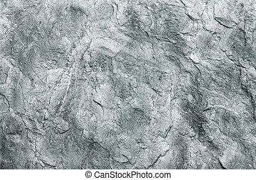 close up of a grey stone wall