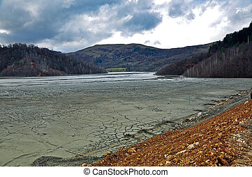 Industrial mine water contamination - Contaminated lake near...
