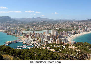 Panoramic view over Calp Spain Town bay beach