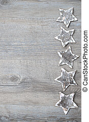 Birch bark stars over the wooden background - Christmas...