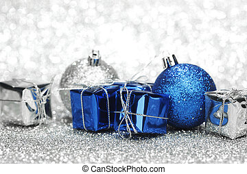 Christmas card with gifts and decoration on shiny silver...