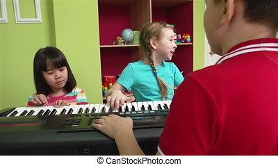 Singing With All Heart - Little girl and her friends playing...