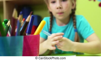 Creative Child - Lovely child being busy drawing with...