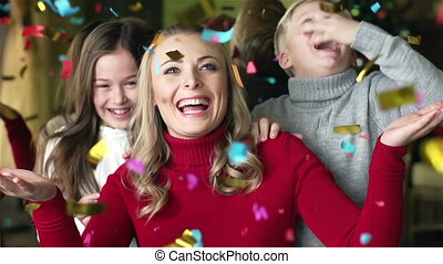 Colorful Confetti - Family of three being excited with...