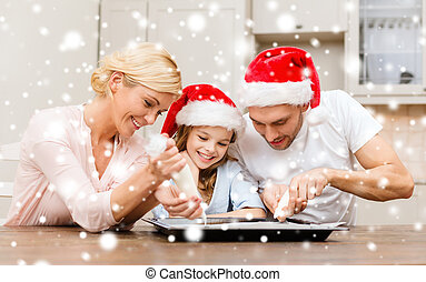 happy family in santa helper hats making cookies - food,...