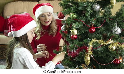Mother, Daughter, Fir-tree - Mother and daughter decorating...