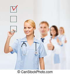 doctor or nurse drawing checkmark into checkbox -...