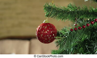 Holiday Decoration - Tilt down of a decorated Christmas tree...