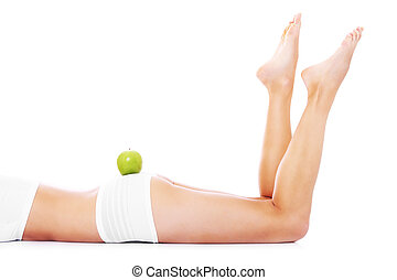 Fit legs - A picture of a fit woman with a green apple on...