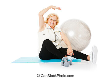Senior Woman Doing Stretching Exercise On Mat