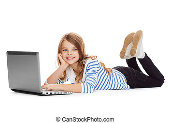 smiling student girl with laptop computer lying - education,...