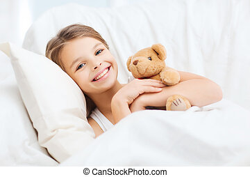little girl with teddy bear sleeping at home - health and...