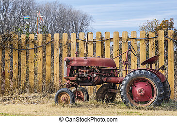 old farm tractor - An old farm tractor in a field