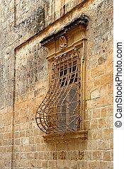 Window trellis - Building exterior with ornamented window...