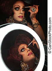Man in Drag with Makeup - Cross dressing man putting on...