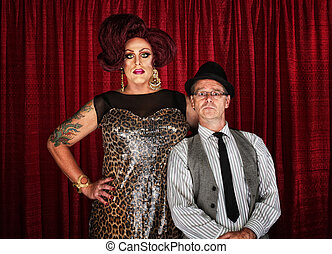 Drag Queen and Retro Man - Odd couple drag queen with man at...