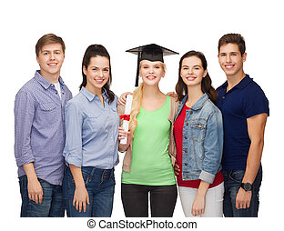 group of standing smiling students with diploma - education...