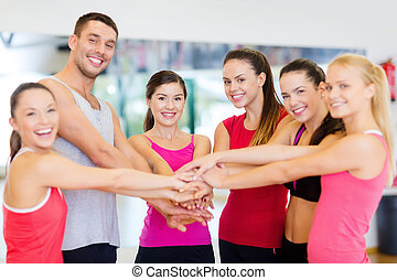 group of people in the gym celebrating victory - fitness,...