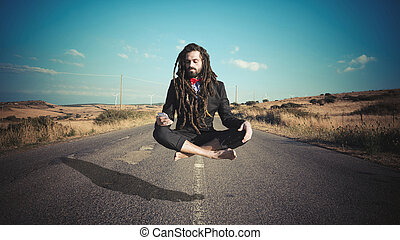 Stylish elegant dreadlocks businessman levitating in a...
