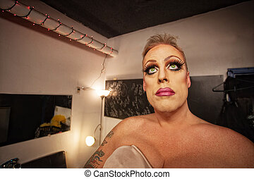 Man in Drag in Dressing Room - Serious male in drag waiting...