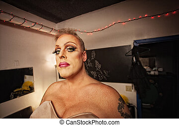 Drag Queen in Dressing Room - Serious drag queen with bra...