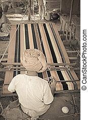 Man Making Ghongadi, desi blanket from sheep wool, India
