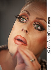 Close Up of Drag Queen - Close up of drag queen putting on...